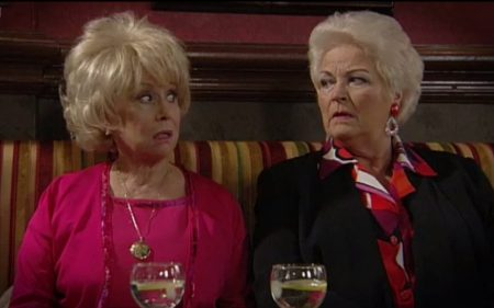 Pat and Peggy in Eastenders looking at each other incredulously