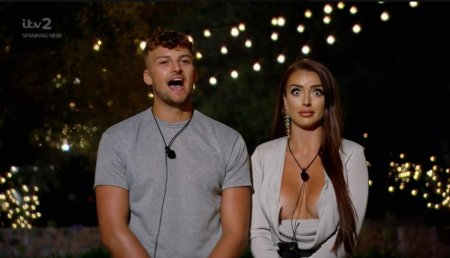 Two people from Love Island looking awkward