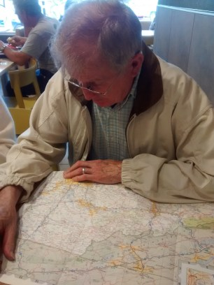Dad studying the map in McDonald's.