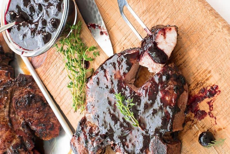 BLUEBERRY BALSAMIC BBQ SAUCED GRILLED PORK CHOPS by senseandedibility.com