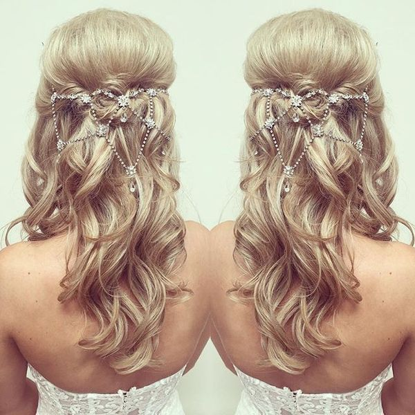 Soft Wavy Bridal Hairstyle with Pretty Accessory - Back View