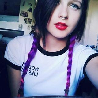 Two purple plaits and black top hair