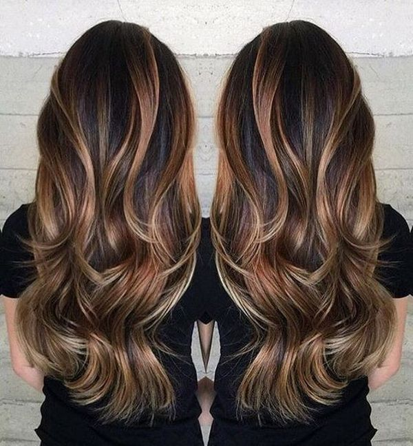 The naturally rich brown hair with dark natural blonde highlights on the thick hair