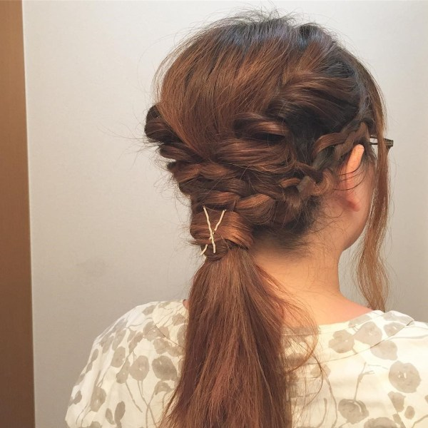 Low ponytail with double braids on sides