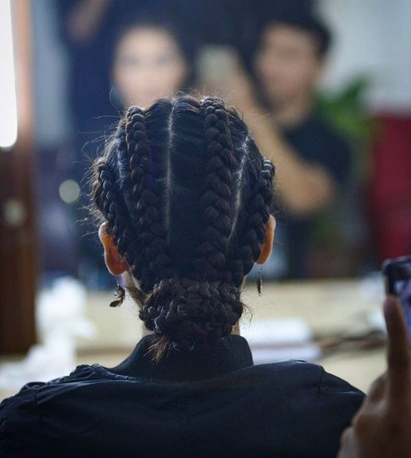 Cornrows and a low knot