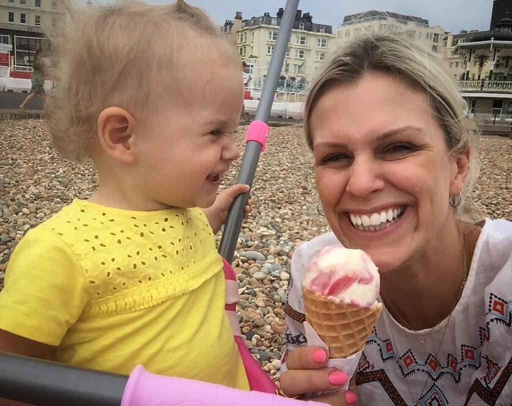 one year old smiling at mum with ice cream