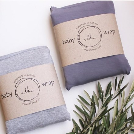 two folded Elki Baby Wraps in grey and blue
