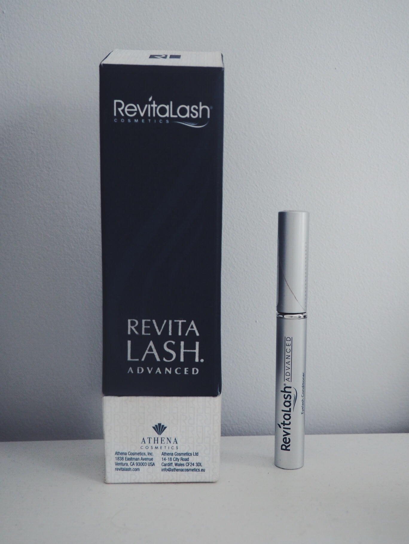 Blue RevitaLash box with product standing next to it