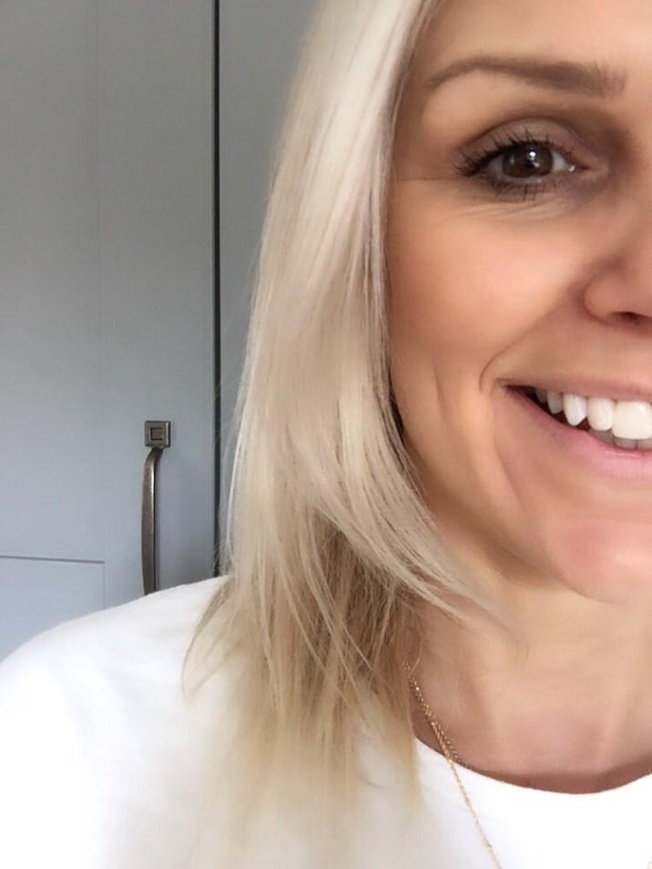 author smiling at long eyelashes