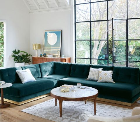 green couch with gold trim