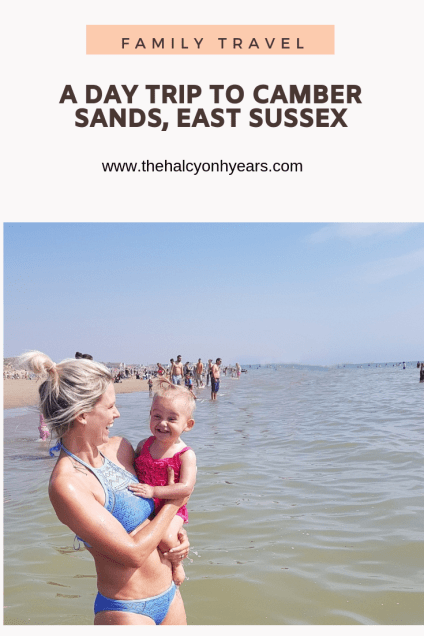 Mum holding baby girl at the seaside | A Day Trip to Camber Sands with a baby | The Halcyon Years