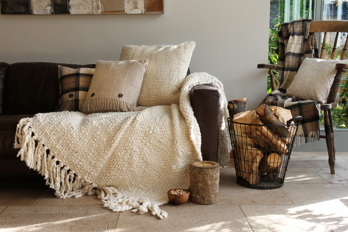 cosy living room with cream throws and cushions