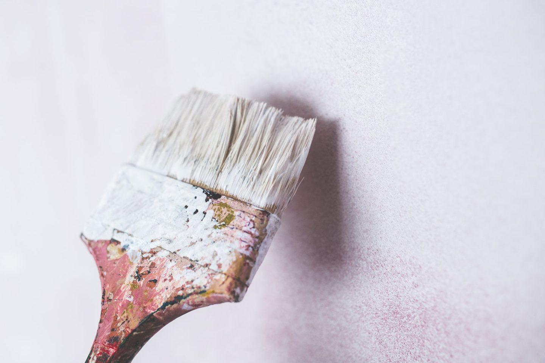 white paint brush against wall