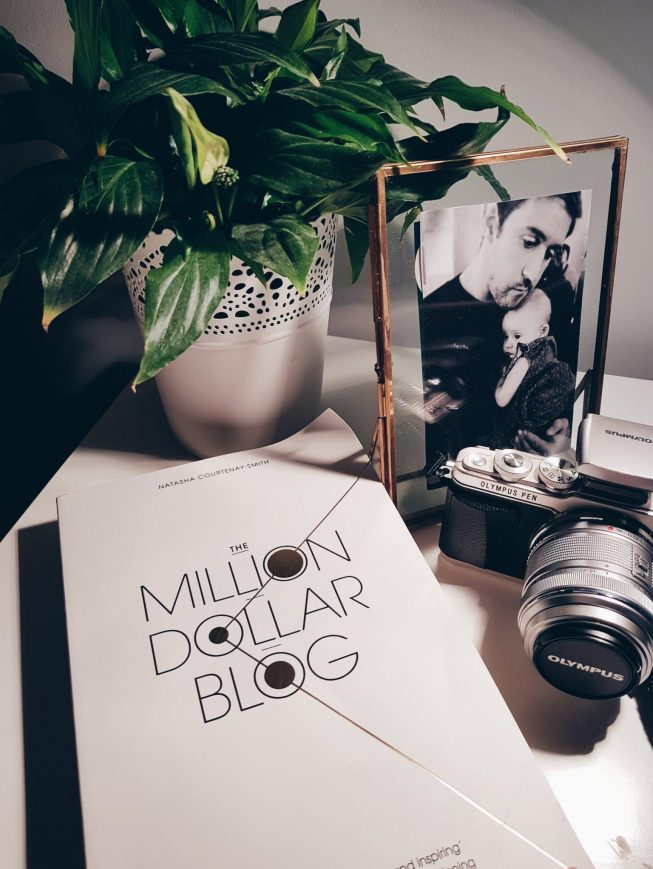 Million Dollar Blog book on bedsite table with Olympus pen camera