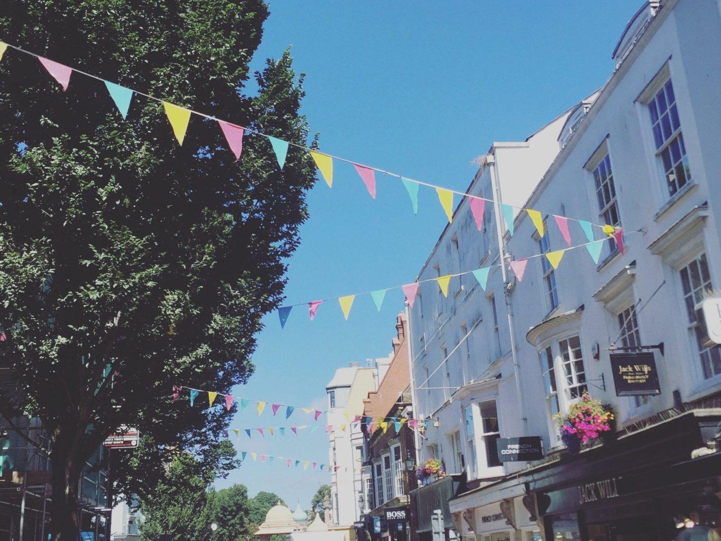 bunting on streets of brighton with blue sky