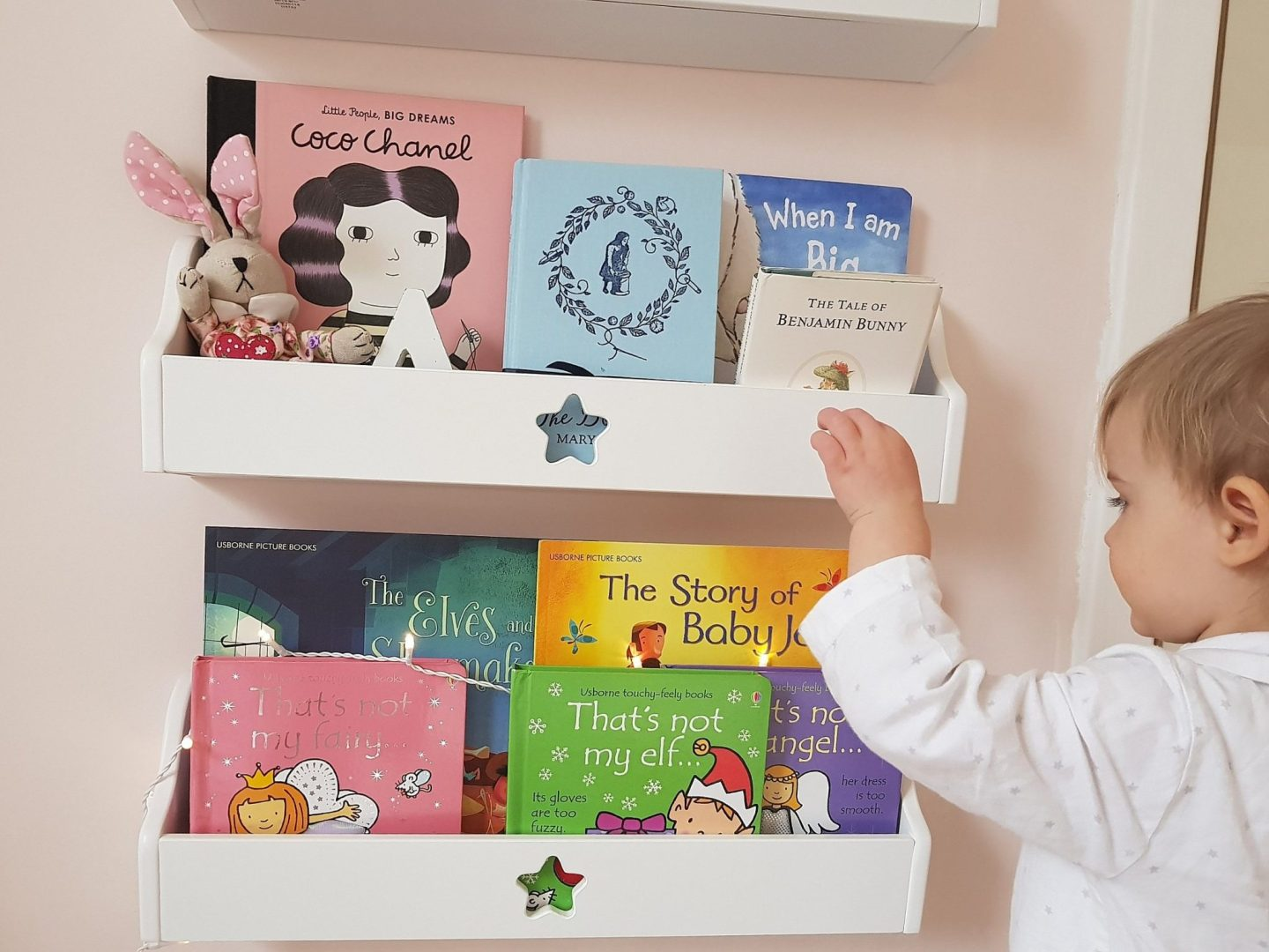 ettie picking Bookabees books off shelf