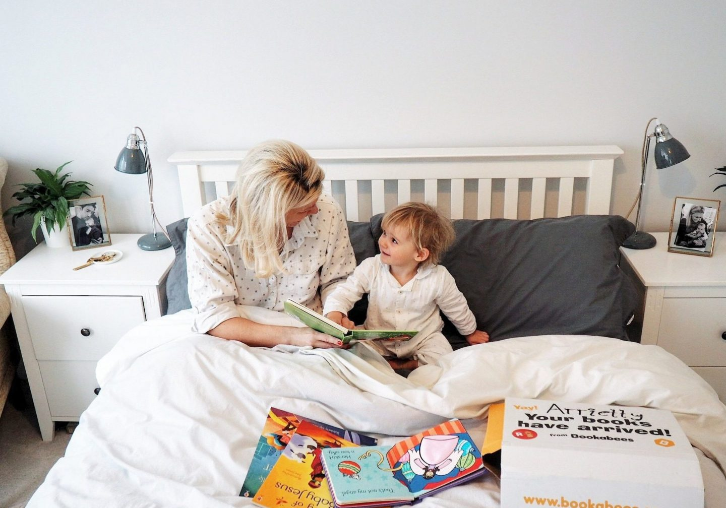Ettie and Mummy reading Bookabees books in bed