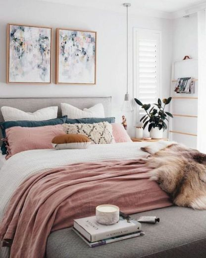 A bed with blush pink throw and cushions| Making the most of light in a small room | The Halcyon Years