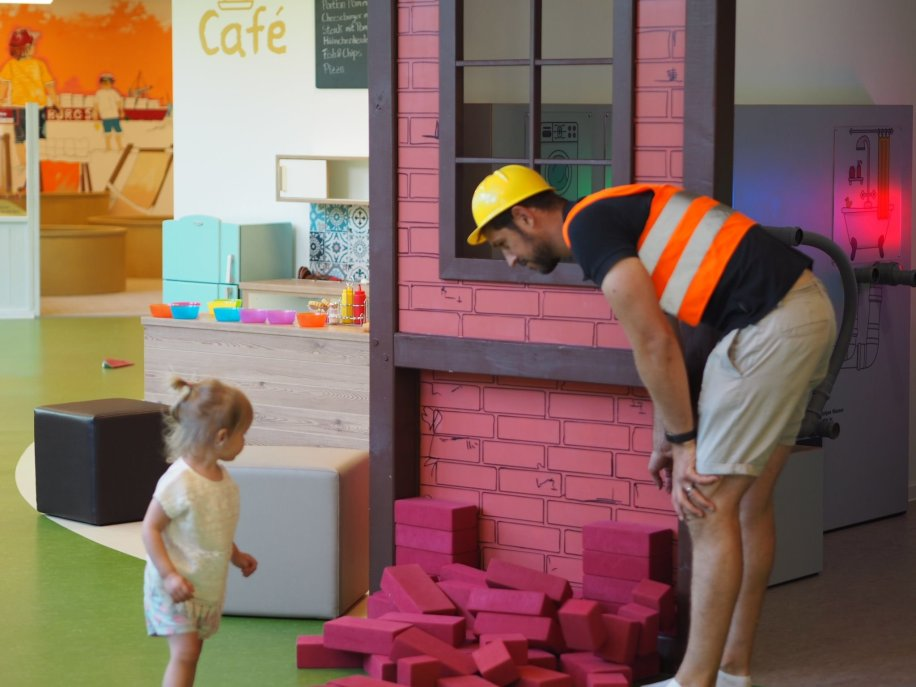 Daddy and daughter building a pretend brick wall, Hamburg with a Toddler | The Halcyon Years