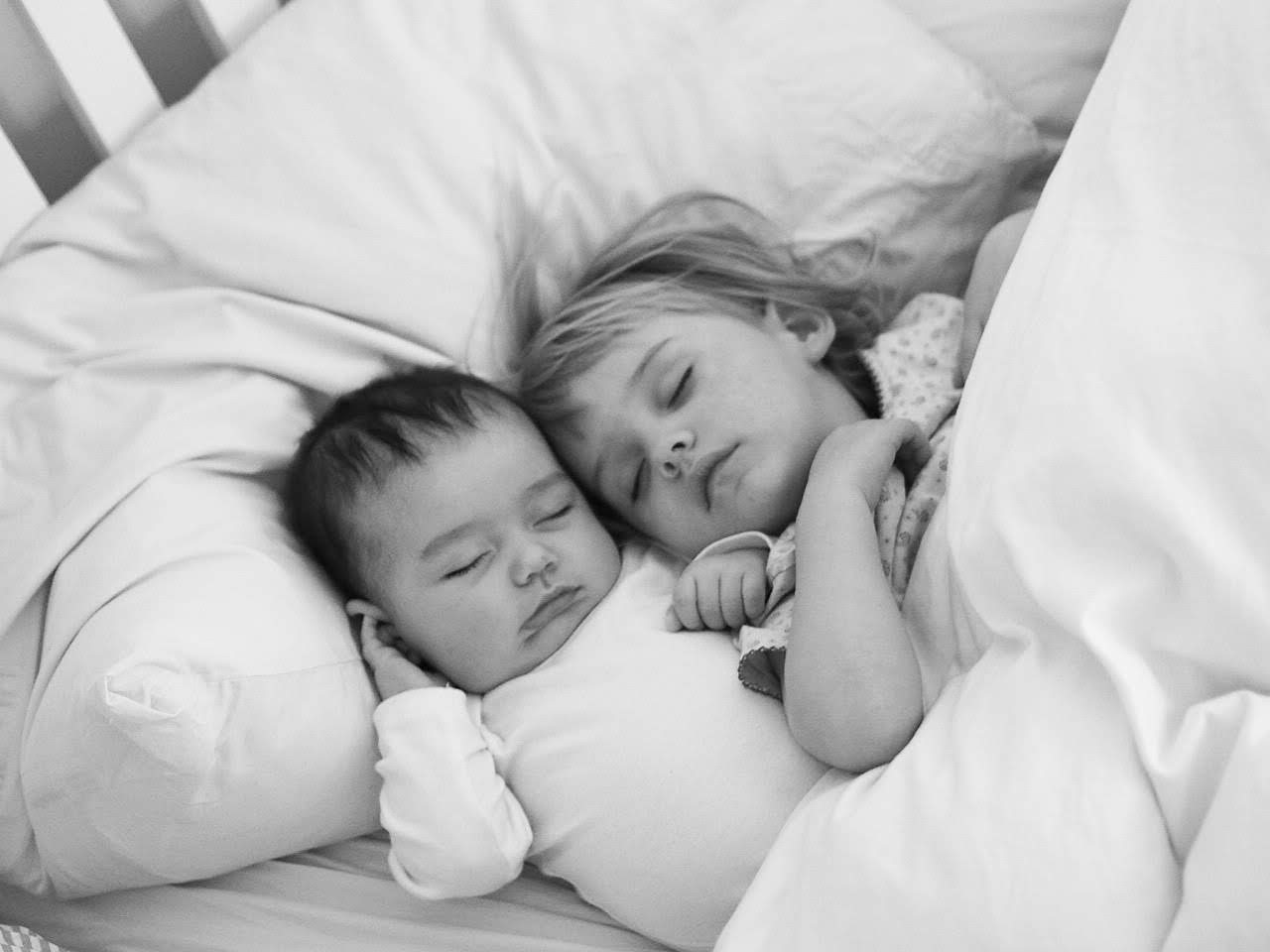 baby brother and two year old sister sleeping next to each other | letters to Ettie 2 years 5 months