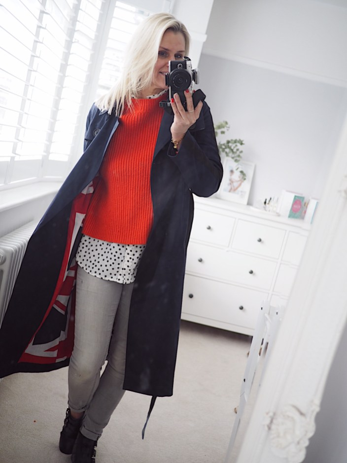 Boden staples for a capsule weekend wardrobe | The Halcyon Years [lady in blue coat, red jumper and grey jeans)