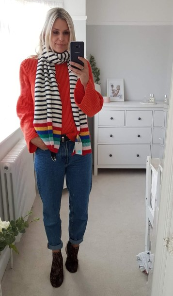 Boden staples for a capsule weekend wardrobe | The Halcyon Years [lady taking selfie in mirror wearing a red jumper and blue jeans with black and white stripey scaft)