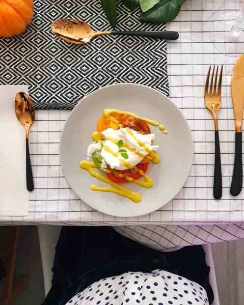 heritage tomatoes with burrata on a grey plate
