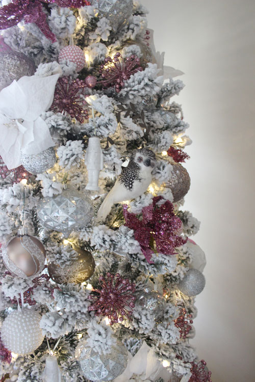 two years ago i picked up a lot of mercury glass and silver ornaments along with the fur tree skirt at home goods when they were half off after the season