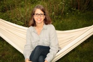 Writer sitting in hammock