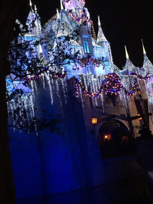Sleeping Beauty's Winter Castle lit up at night.