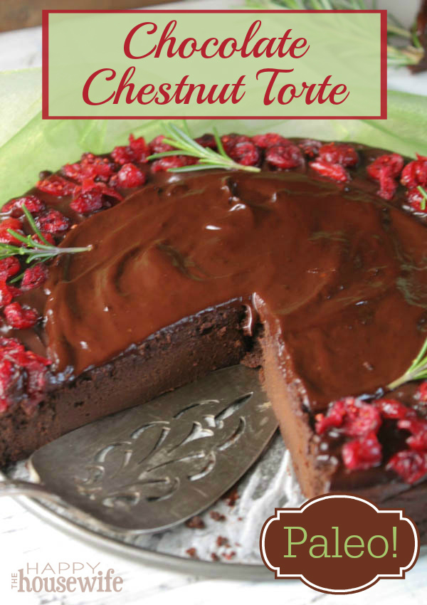 This decadent, rich, chocolate chestnut torte can be made with paleo ingredients and topped with ganache and cranberries for a beautiful holiday dessert. Found at The Happy Housewife