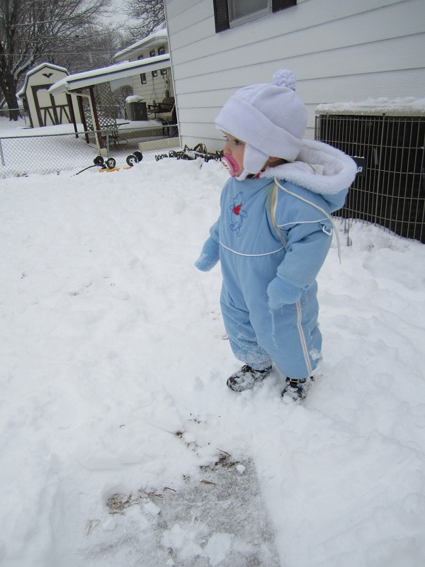 Baby girl in snowsuit