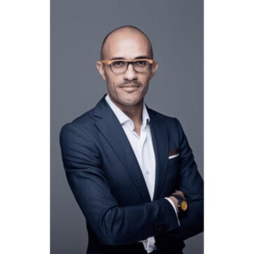 bald man wearing glasses