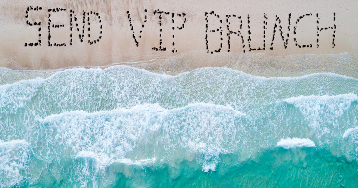 """Distressed Fyre Festival Attendees on Beach Spell Out """"SEND VIP BRUNCH"""" with Rocks"""