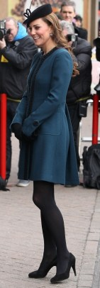 Wearing a coatdress during a tour of the London Underground with the Queen