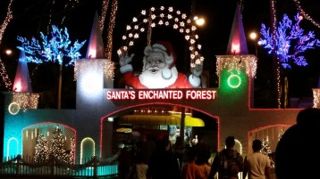 The entrance to the park glowed as a lit up Santa greeted us merrily.