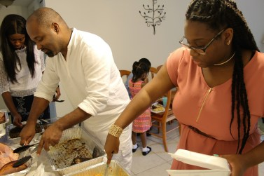 """Cassy and Uncle Patrick dig in when """"Brunch"""" is finally ready."""