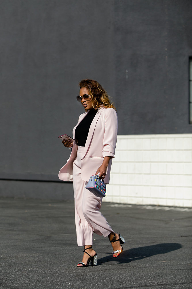 Hautemommie wears pink suit and carries phone covered in Kate Spade