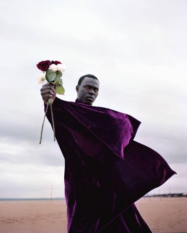 Man with purple cape with flowers weekend seekers guide chicago