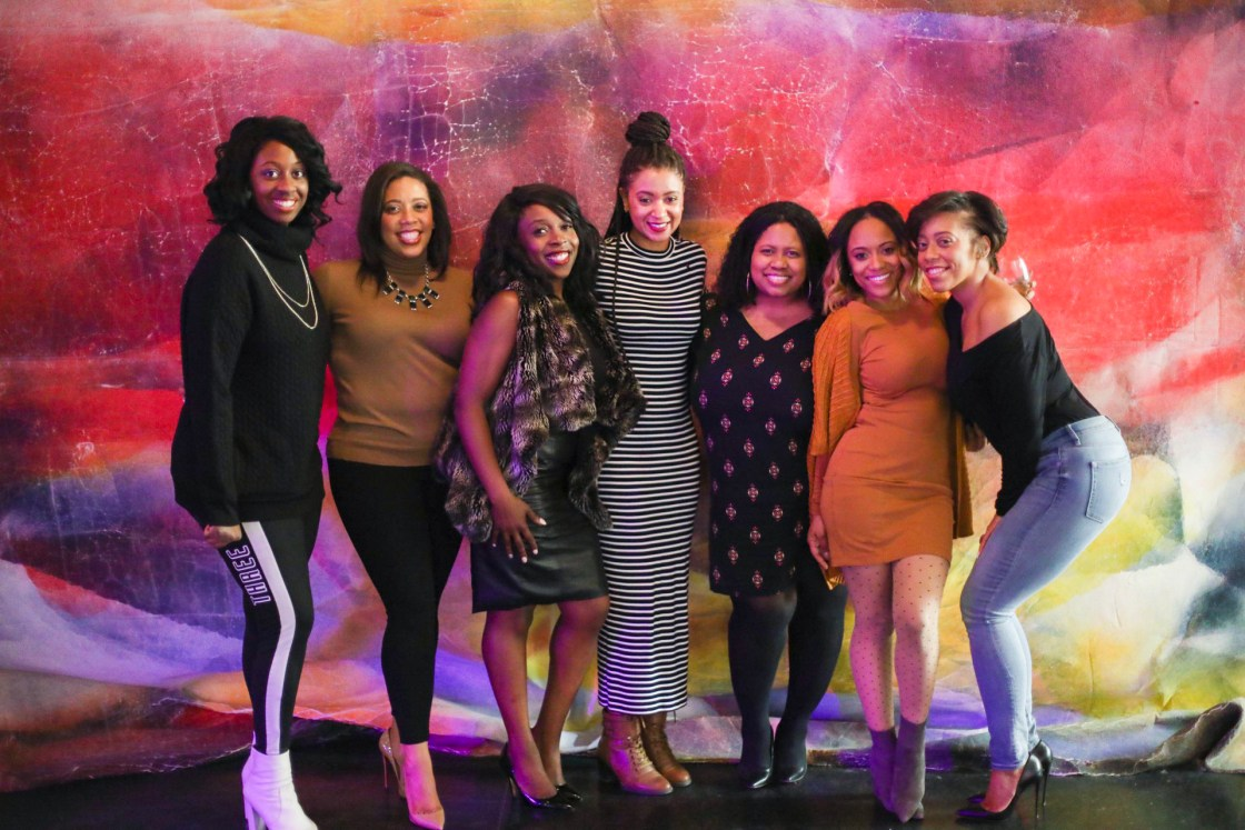 Seven black women smiling and laughing at the Ace Hotel in Chicago for the Changemakers event by Bumble photography by Jasmine Oliver