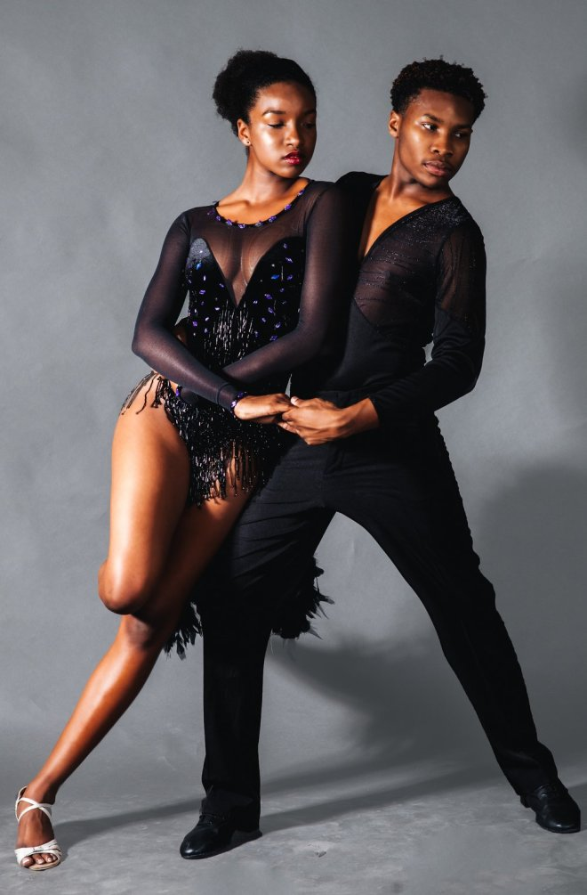 Black man and black woman in dancewear. Image featured on The Haute Seeker list of cool and cheap things to do on a weekday in chicago