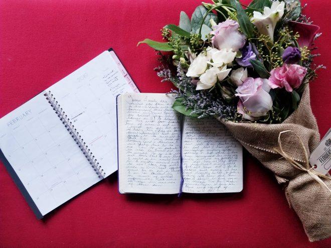 A planner and journal open alongside a bouquet of flowers by Flowers for Dreams in Chicago.