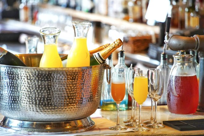 Champagne and orange juice glasses  at Bar Roma in Chicago as featured in The Haute Seeker Bottomless Brunch Guide
