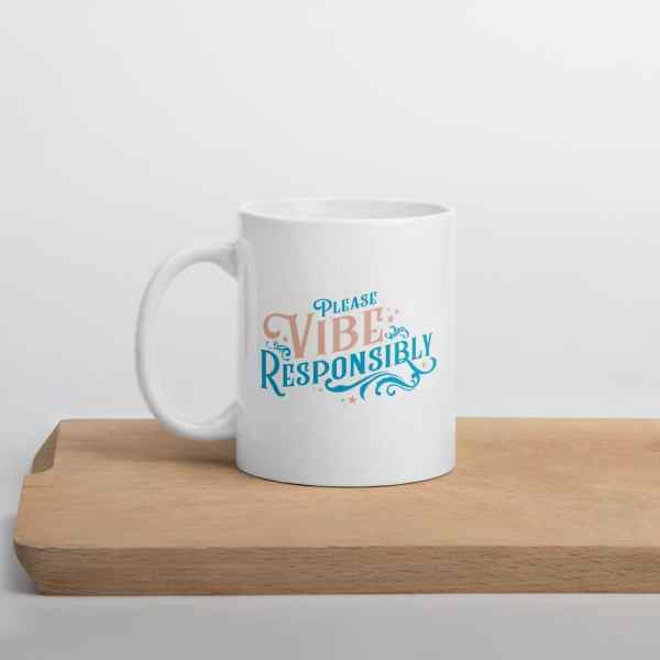 Please Vibe Responsibly inspirational mug on cutting board