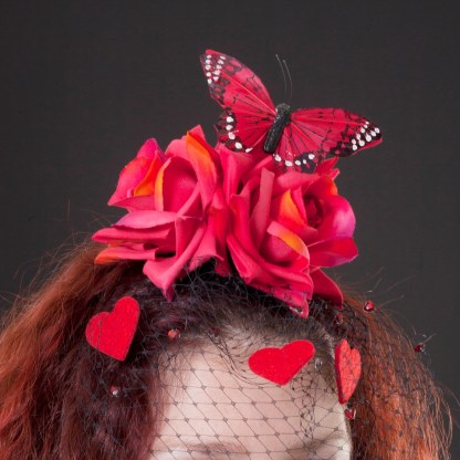 Red roses, butterfly and felt heart fascinator