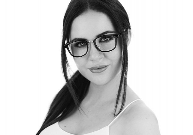 Black and white image of a black haired girl with glasses
