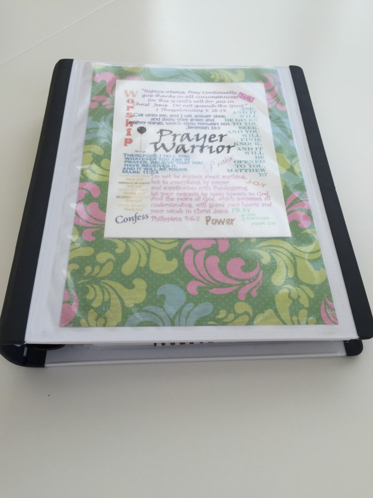 In the cover of my notebook I put decorative scrapbook paper and a Scripture collage I printed out.