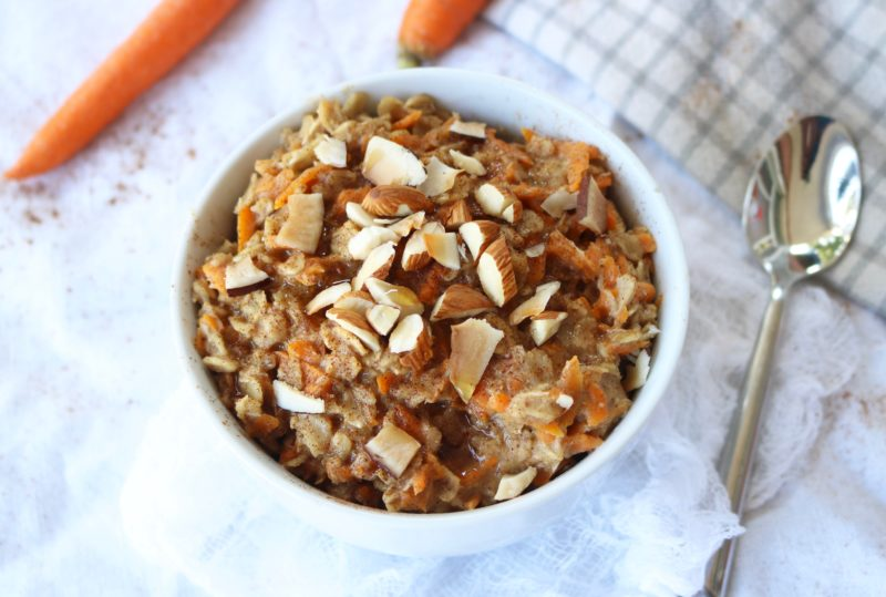Healthy and easy carrot cake oatmeal breakfast recipe. This delicious oatmeal is vegan, gluten free, and sweetened with only maple syrup. Overnight oats and microwave options provided.
