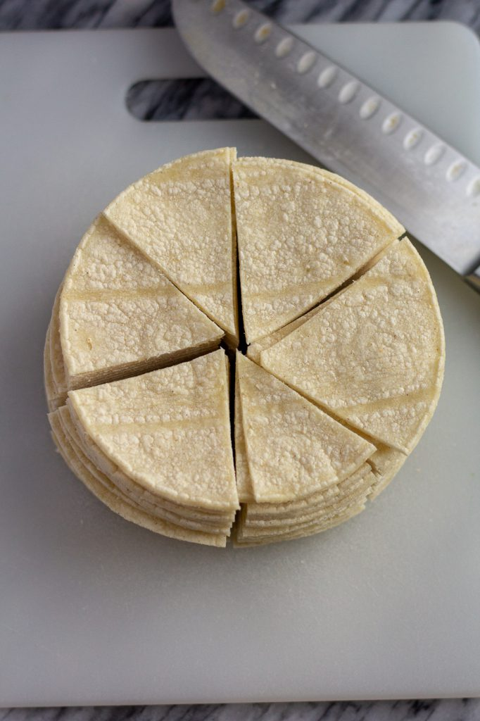 Corn tortillas cut into sixths