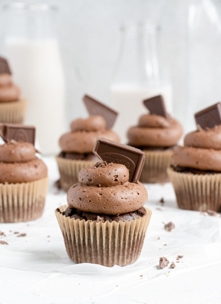 chocolate cupcakes with frosting and shaved chocolate